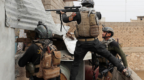 FILE PHOTO: An Iraqi special forces soldier fires a sniper rifle during a battle with Islamic State militants in Mosul, Iraq © Goran Tomasevic