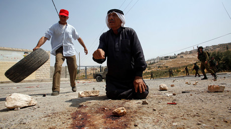 A Palestinian man gestures at the scene where a Palestinian who attempted to stab Israeli soldiers was shot dead by Israeli troops in the West Bank village of Tuqu near Bethlehem July 20, 2017. © Mussa Qawasma