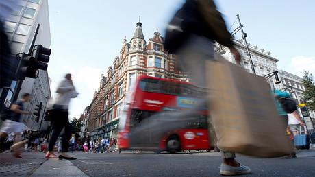 Shoppers cross the road in Oxford Street, London, Britain. © Peter Nicholls