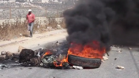 Clashes erupt in West Bank after Israel raids & locks area