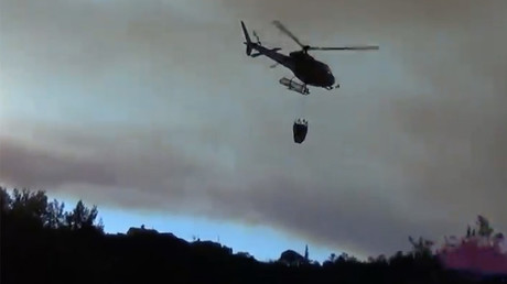 Portuguese firefighters use helicopters to tackle wildfire near Coimbra