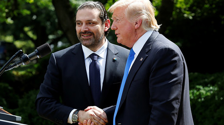 U.S. President Donald Trump (R) shakes hands with Lebanese Prime Minister Saad Hariri after their meeting at the White House in Washington, U.S., July 25, 2017. © Yuri Gripas