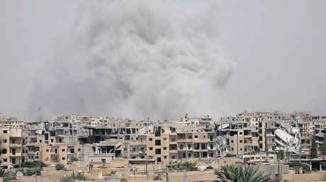 Smoke rises from Raqqa city © Rodi Said