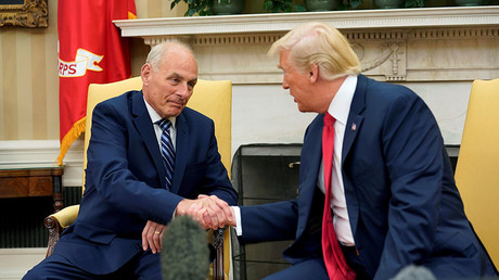 U.S. President Donald Trump shakes hands with John Kelly after he was sworn in as White House Chief of Staff in the Oval Office of the White House in Washington, U.S., July 31, 2017. © Joshua Roberts