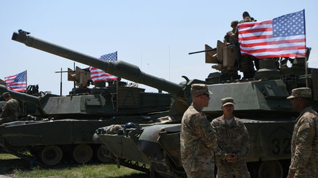 US soldiers stand by Abrams Battle Tanks prior to the opening ceremony of the multinational military exercise 'Noble Partner 2017' at the military base of Vaziani, on July 30, 2017 © Vano Shlamov