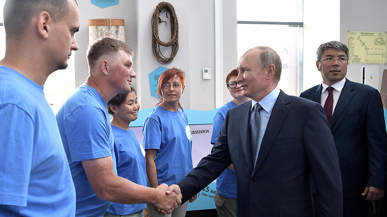 Putin gives first public indication of 2018 presidential run