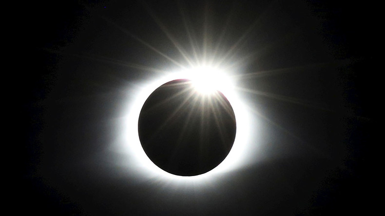 Rare total eclipse has Americans looking skywards