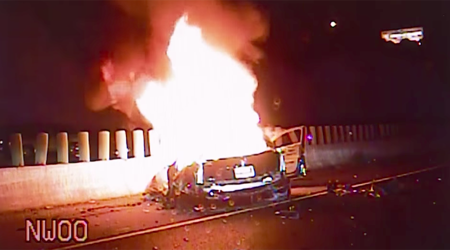 Cops drag couple from blazing wreckage after car plunges off bridge (VIDEO)
