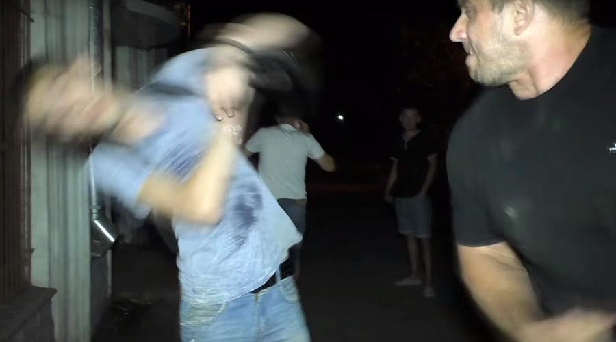 Ukrainian powerlifter beats up group of men on camera