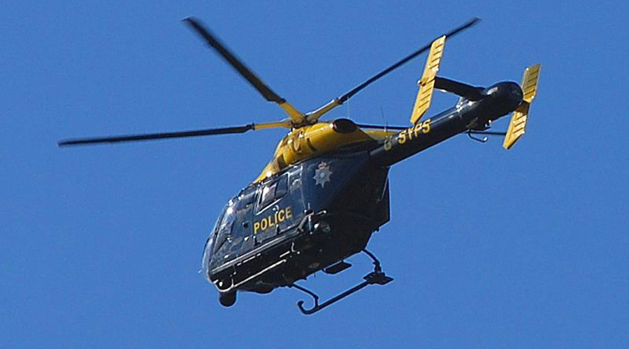 Police officers and pilots cleared over helicopter sex footage