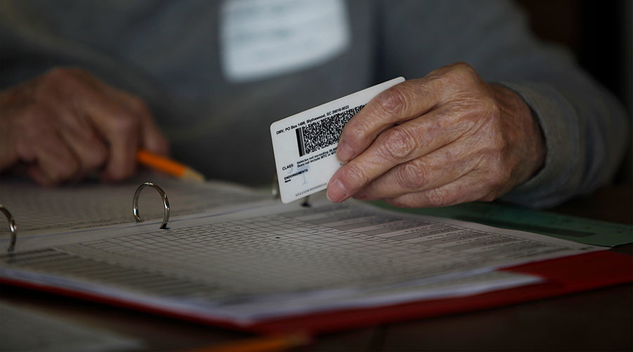Federal Judge Cuts Down Texas Voter ID Law
