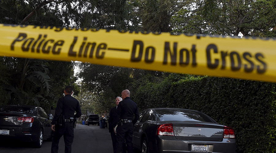 Officer fatally shot in California hotel shootout, 2 wounded