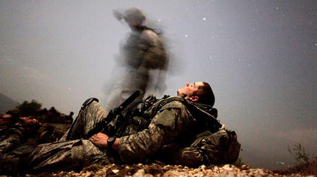 FILE PHOTO: A US soldier of 2-12 Infantry 4BCT-4ID Task Force Mountain Warrior takes a break during a night mission near Honaker Miracle camp at the Pesh valley of Kunar Province. © Carlos Barria / Reuters
