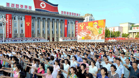People participate in a Pyongyang city mass rally held at Kim Il Sung Square on August 9, 2017 © KCNA