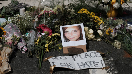 Flowers and a photo of car-ramming victim Heather Heyer lie at a makeshift memorial in Charlottesville, Virginia © Justin Ide