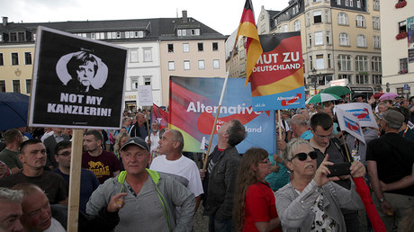 Alternative for Germany party supporters protest during the election rally of the German Chancellor Angela Merkel ) in Annaberg-Buchholz, Germany August 17, 2017 © Matthias Schumann