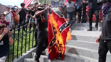 Torched Confederate flag & witch costumes: Activists protest against 'Free speech' rally in Boston