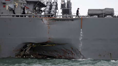 The U.S. Navy guided-missile destroyer USS John S. McCain is seen after a collision, in Singapore waters August 21, 2017. © Ahmad Masood