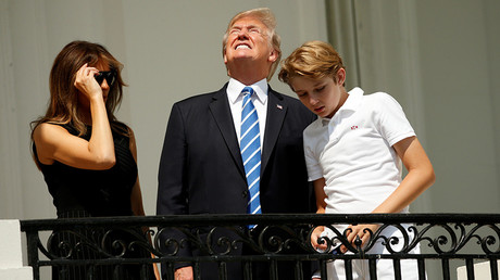 Sun king: Trump looks at solar eclipse without protective glasses