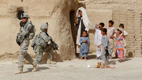 US soldiers secure an area beside Afghan children during a patrol in the village of Gorgan in Dand district, south of Kandahar, June 28, 2010 © Denis Sinyakov