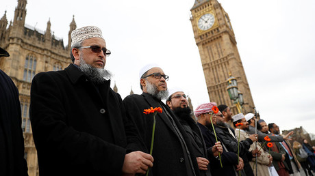 Muslim men stand in line on Westminster Bridge during an event to mark one week since a man drove his car into pedestrians then stabbed a police officer in London, Britain, March 29, 2017. ©Stefan Wermuth
