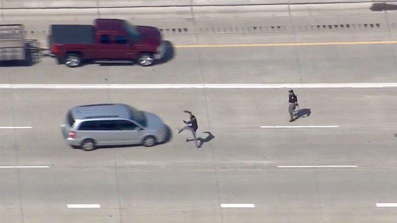 Leapin' loser! Detroit police chase ends with suspect jumping onto oncoming minivan (VIDEO)