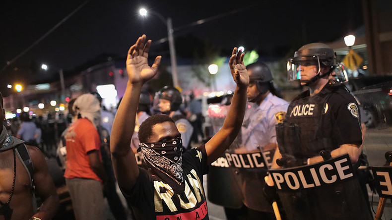 'Point of action is to disturb': Silent protesters block St. Louis City Hall