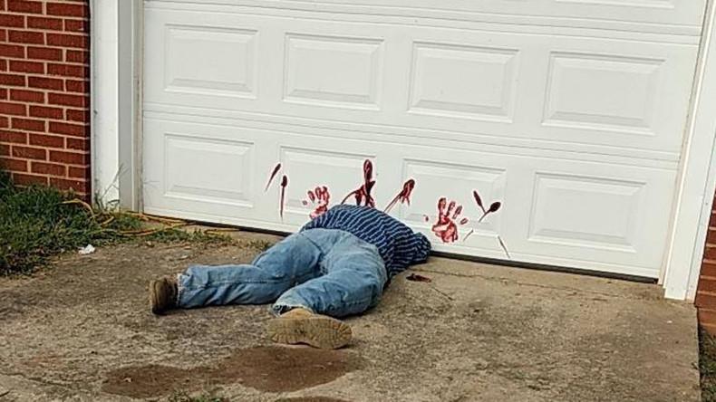 'Bloodied dead body' under garage door triggers flood of 911 calls (PHOTO)