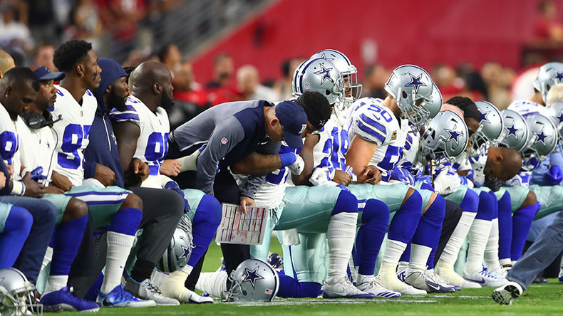 Crowd boos Cowboys as they take the knee before national anthem