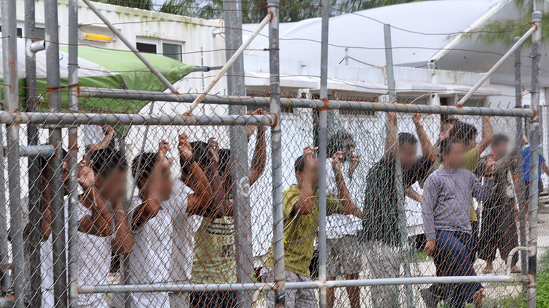 Refugees depart Australian camps for US in deal slammed as 'dumb' by Trump