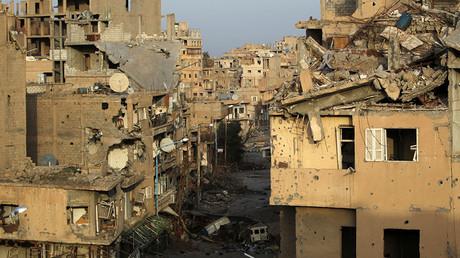 FILE PHOTO: A view shows damaged buildings in Deir-ez-Zor, eastern Syria. ©Khalil Ashawi