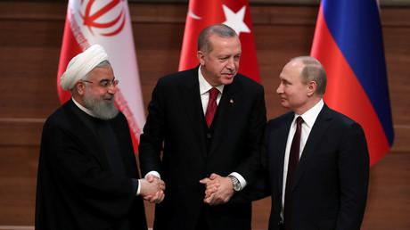 Presidents Hassan Rouhani, Tayyip Erdogan and Vladimir Putin © Umit Bektas