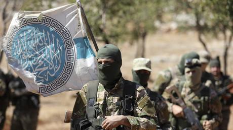 Hayat Tahrir al-Sham (HTS) militants at a camp in Syria's province of Idlib on August 14, 2018. © Omar Haj Kadour