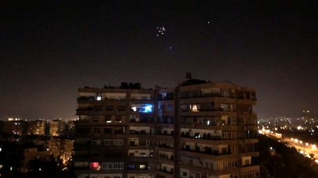 FILE PHOTO. Syrian air defense missiles are seen in the sky over the city of Damascus. © Hummam Sheikh Ali / Xinhua
