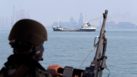 A US Navy soldier onboard Mark VI Patrol Boat stands guard as an oil tanker makes its way towards Bahrain port © Hamad I Mohammed