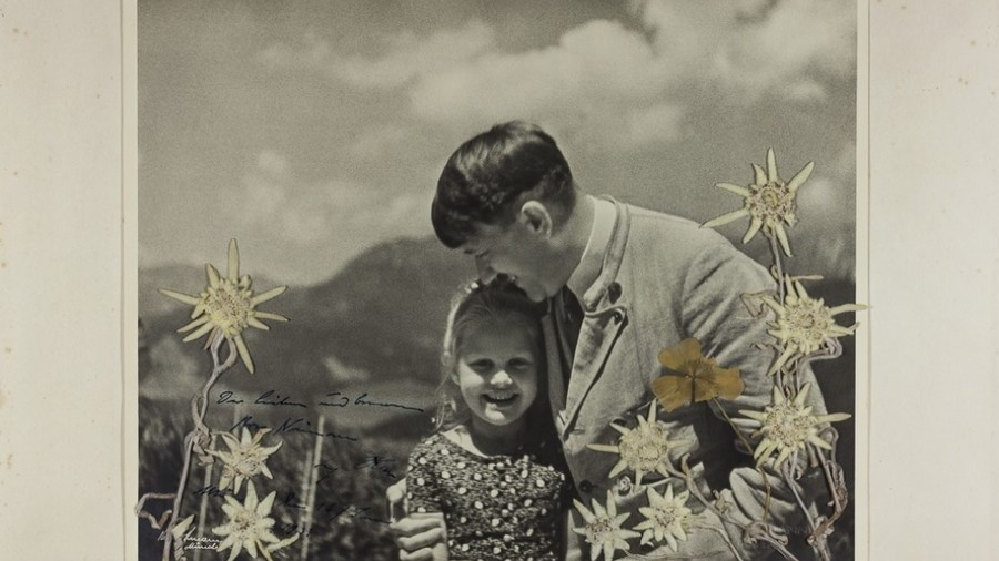 'Fuehrer's child': Stunning photo of Hitler hugging Jewish girl goes on sale in US