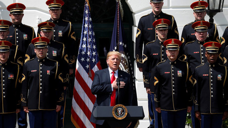 Donald Trump along with members of the US military at the