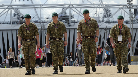 FILE PHOTO: Members of the British army walk around the Olympic park in Stratford, East London