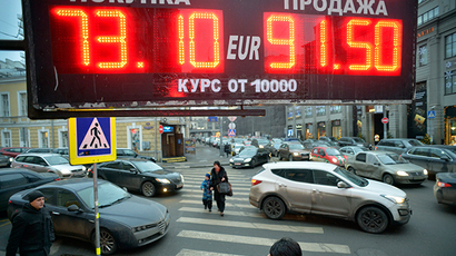 Board listing foreign currency rates against the Russian ruble outside an exchange office in central Moscow, on December 17, 2014. (AFP Photo / Yuri Kadobnov)
