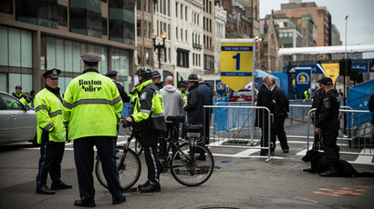 Police officers stand guard near the finish line for the Boston Marathon on the one year anniversary of the 2013 Boston Marathon Bombing , on April 15, 2014 in Boston.(AFP Photo / Andrew Burton)