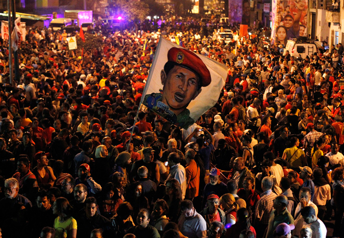 Supporters of Venezuela's President Hugo Chavez react to the announcement of his death outside the hospital where he was being treated, in Caracas March 5, 2013 (Reuters / Carlos Garcia Rawlins)