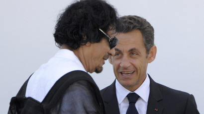 Libyan Leader Moamer Kadhafi and French President Nicolas Sarkozy speak after a meeting of the Group of Eight (G8) and participating African countries during the G8 summit in L'Aquila, in central Italy, on July 10, 2009. (AFP Photo)