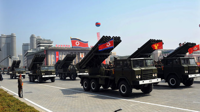 North Korean soldiers ride on the back of MLRS (mutliple launch rocket system).(AFP Photo / Pedro Ugarte)