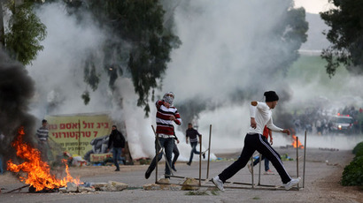 Palestinian protestors hurl stones at Israeli police during clashes at the entrance of the Jalama checkpoint, near the West Bank city of Jenin, on February 22, 2013.(AFP Photo / Saif Dahlah)