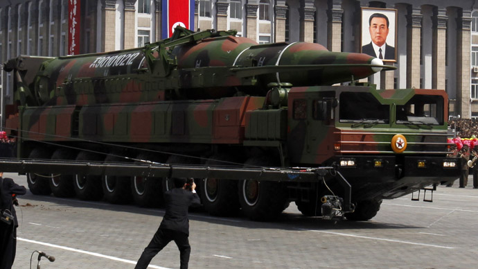 State media film a rocket carried by a military vehicle during a military parade to celebrate the centenary of the birth of Kim Il-sung in Pyongyang April 15, 2012. (Reuters/Bobby Yip)