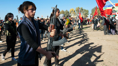 Syrian-Kurdish women stand guard during the funeral of a comrade. (AFP Photo / Giulio Petrocco)
