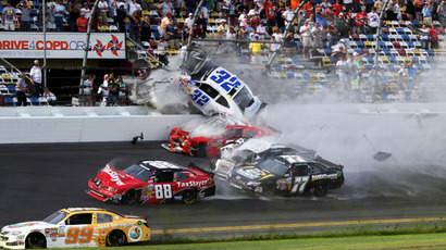 An incident at the finish of the NASCAR Nationwide Series DRIVE4COPD 300 at Daytona International Speedway on February 23, 2013. (AFP Photo / Jerry Markland)