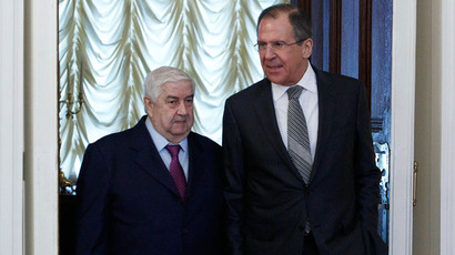 Russia's Foreign Minister Sergei Lavrov (R) and his Syrian counterpart Walid al-Moualem walk into a hall during a meeting in Moscow, February 25, 2013.(Reuters / Sergei Karpukhin)