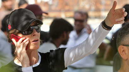 "Kathryn Bigelow speaks on a mobile phone during a shoot at the film location of the movie ""Zero Dark Thirty"" in the northern Indian city of Chandigarh March 17, 2012 (Reuters / Ajay Verma)"