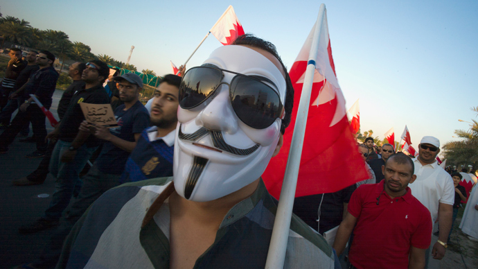 A protester in a Guy Fawkes mask participates in an anti-government rally organised by Bahrain's main opposition society Al Wefaq in Budaiya, west of Manama, February 15, 2013 (Reuters / Hamad I Mohammed)